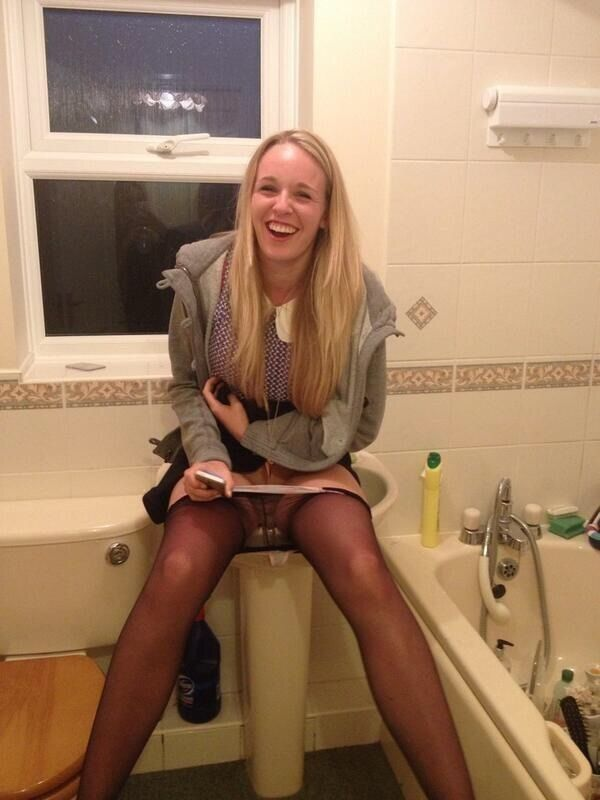 Embarrassed girl pissing