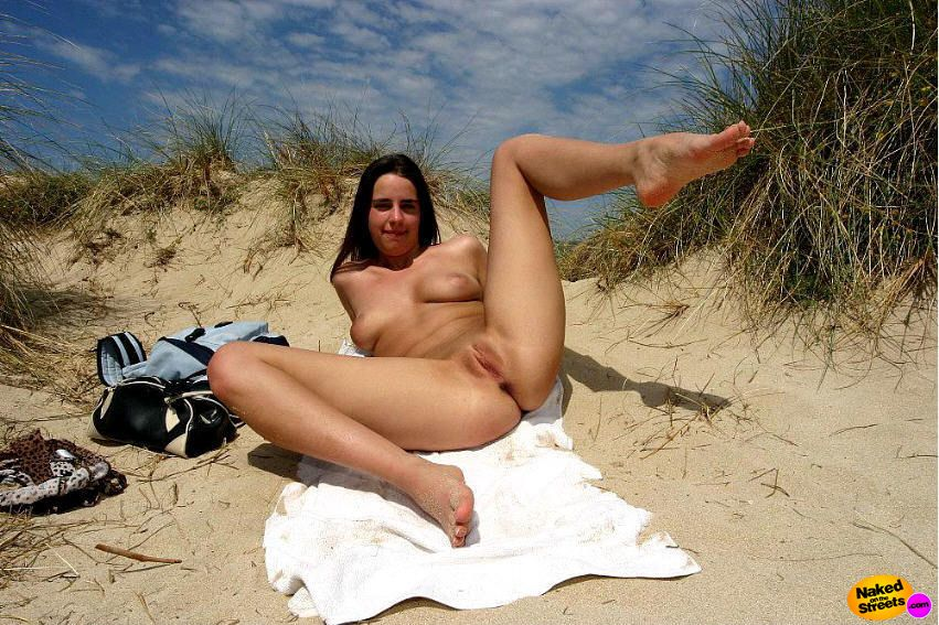 Lonely girl on nude beach excited too