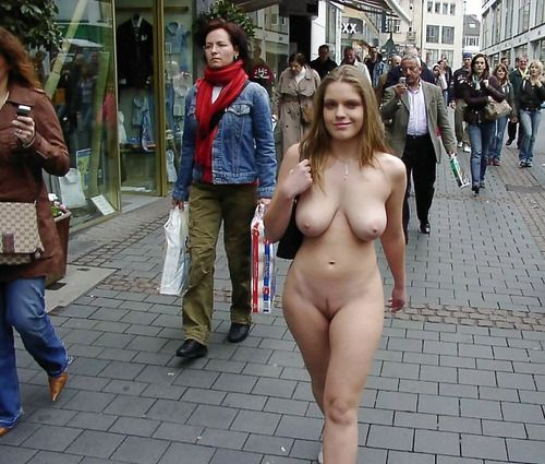 Women walks nude down street